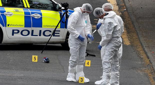 Forensic officers at the scene of an incident in Gateside Gardens, Greenock, where two police officers were injured (Andrew Milligan/PA)