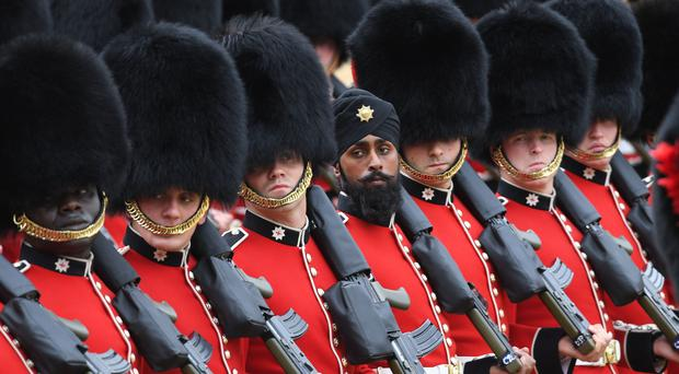 A Sikh member of the Coldstream Guards wearing a turban takes part in the Colonel's Review (Stefan Rousseau/PA)