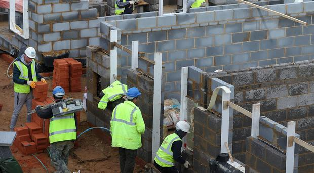 Construction output remained at a steady level last month (PA)