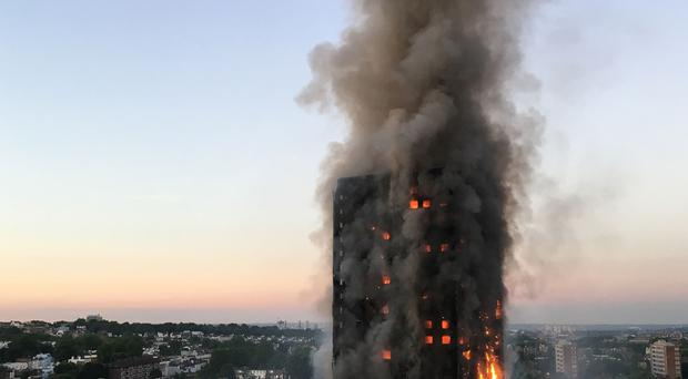 Footage taken by residents and people in the area showed fiery debris falling from the block (Natalie Oxford/PA)