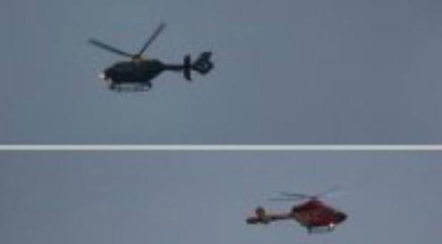 Police and air ambulance helicopters after a woman and baby were stabbed in Hanworth (@timstollery/PA)