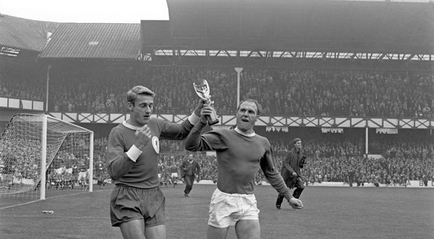 Ray Wilson, right, and Roger Hunt with the Jules Rimet trophy (PA)