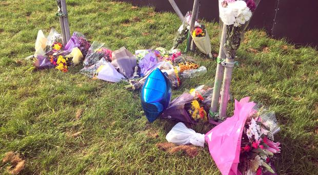 Floral tributes left at the site of the Mutiny Festival in Portsmouth (Flora Thompson/PA)