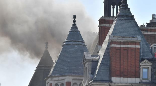 Smoke rising from a building in Knightsbridge, central London, as 97 firefighters and officers have been called to the fire (John Stillwell/PA)