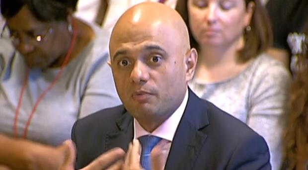 Home Secretary Sajid Javid gives evidence to the parliamentary committee on human rights (PA)
