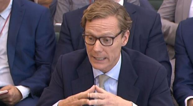 Former Cambridge Analytica chief executive Alexander Nix giving evidence to the inquiry into fake news (PA)