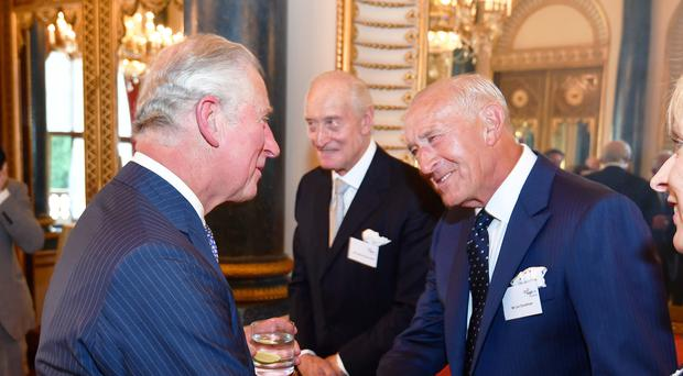 The Prince of Wales with Charles Dance and Len Goodman during a reception for Age UK at Buckingham Palace (John Stillwell/PA)