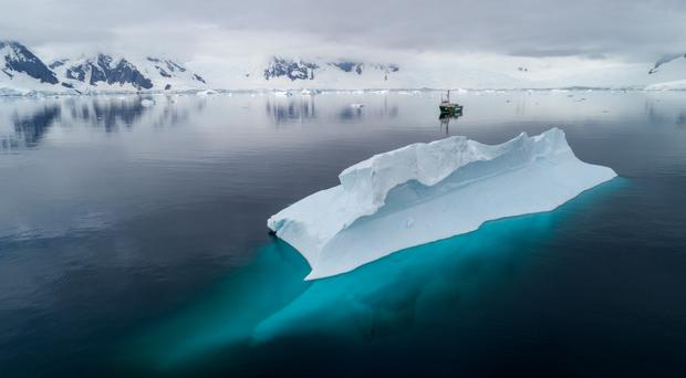 An expedition by Greenpeace to Antarctica found microplastics and persistent chemicals in seawater and ice (Christian Aslund/Greenpeace/PA)