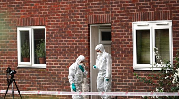 Forensics officers at the scene in Hanworth, west London (Steve Parsons/PA)
