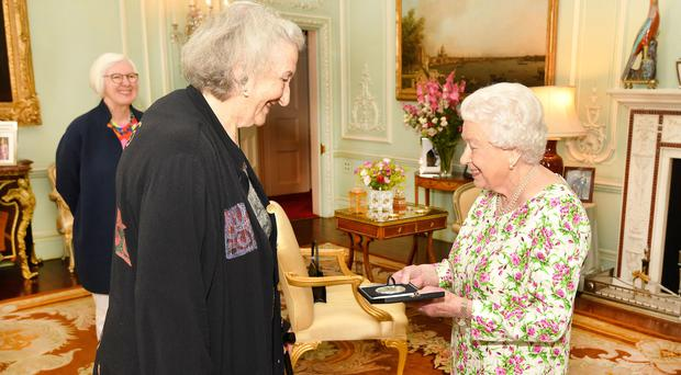The Queen presents the award to Thea Musgrave as Judith Weir, Master of the Queen's Music, looks on (John Stillwell/PA)