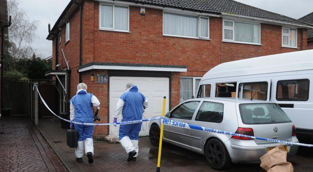 Forensic officers at the house near Bromsgrove where Melanie Clark was found dead (Matthew Cooper/PA)