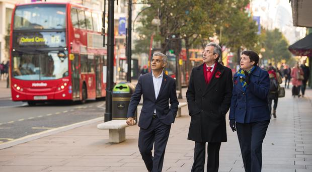 Mayor of London Sadiq Khan, left, Deputy Leader of Westminster Council Robert Davis and Deputy Mayor of London for Transport Val Shawcross on Oxford Street (Dominic Lipinski/PA)