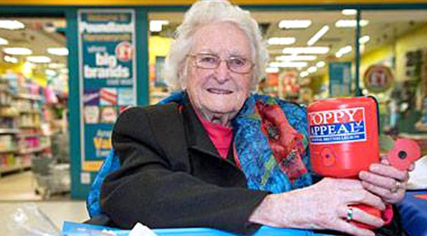 Rosemary Powell collecting for the poppy appeal in London (Royal British Legion/PA)