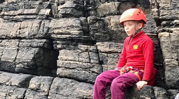 Edward Mills, eight, has climbed the Old Man of Hoy off Orkney to raise cash for a cancer charity (Rebecca Christian/PA)