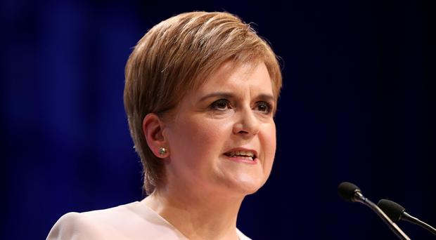 First Minister Nicola Sturgeon delivers her keynote speech to delegates at the Scottish National Party's spring conference (Jane Barlow/PA)