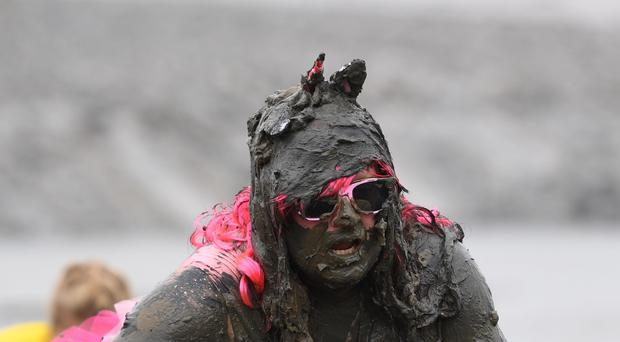 A competitor during the Maldon Mud Race, a charity event on the River Blackwater in Maldon, Essex (Joe Giddens/PA)