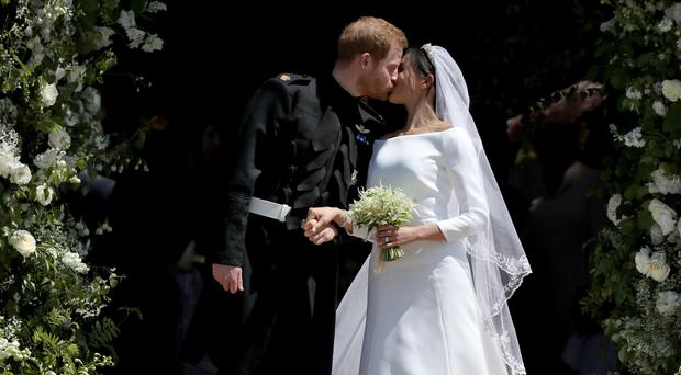 Prince Harry and Meghan Markle kiss outside St George's Chapel in Windsor Castle after their wedding (Jane Barlow/PA)