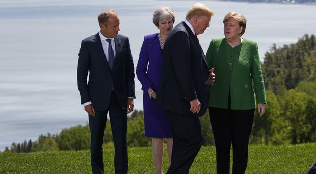 Theresa May's spokesman has said Number 10 expects the US to honour its G7 commitments (AP Photo/Evan Vucci)