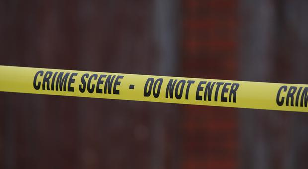 Crime scene tape at a murder investigation site (Peter Byrne/PA)