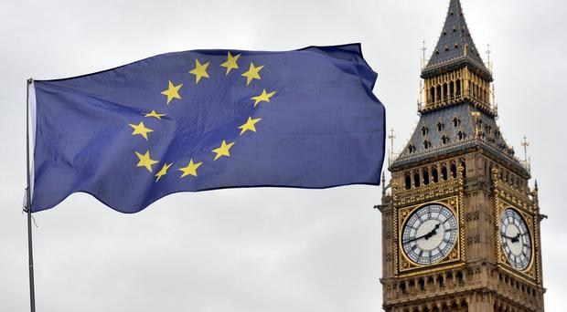 An EU flag flying in front of the Houses of Parliament in London (Victoria Jones/PA)