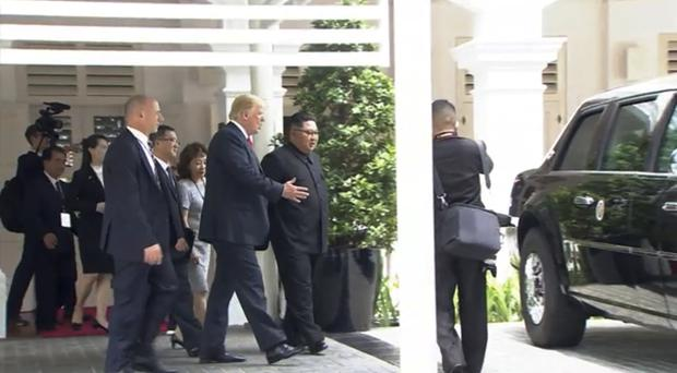 Donald Trump shows North Korean leader Kim Jong Un his presidential vehicle (Host Broadcaster Mediacorp Pte Ltd/AP)