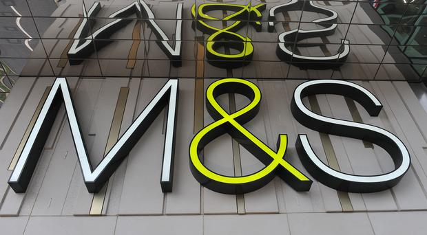 File photo dated 23/10/12 of a Marks and Spencer sign.