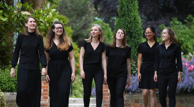 Claire Innes-Hopkins, Ellie Carter, Anna Lapwood, Katy Silverman, Jessica Lim and Lucy Morrell, who make up part of a team of female organists who will perform the complete organ works of Bach over 24 hours, at Pembroke College in Cambridge (Joe Giddens/ PA)