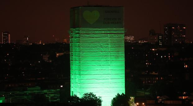 Grenfell Tower in west London is illuminated in green (Jonathan Brady/PA)