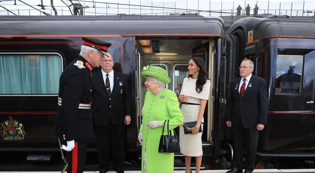 The Queen and Meghan arrive by Royal Train at Runcorn Station (Peter Byrne/PA Wire)