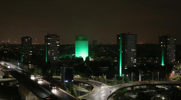 Grenfell Tower is illuminated in green (Jonathan Brady/PA)