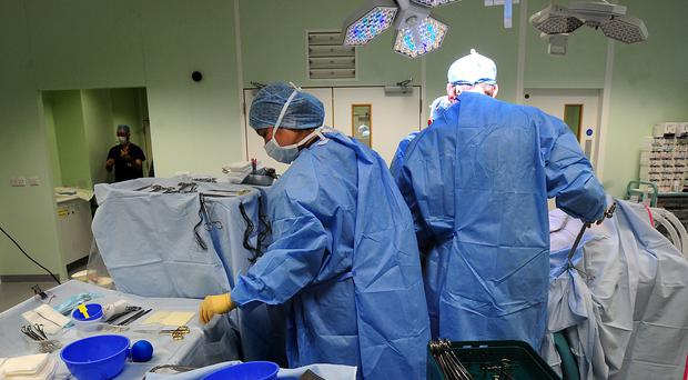 A generic stock photo of an operation taking place at Queen Elizabeth Hospital, Birmingham (Rui Vieira/PA)