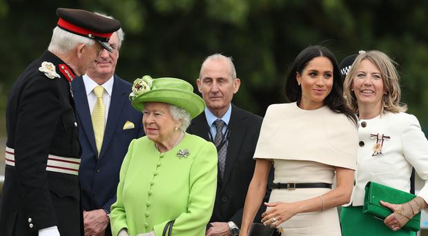 Queen Elizabeth II and the Duchess of Sussex (second right) arrive to open the new Mersey Gateway Bridge, in Widnes, Cheshire.