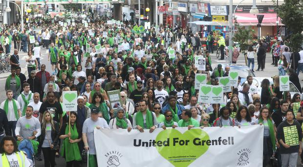 People take part in a silent walk by Grenfell Tower (Rick Findler/PA)