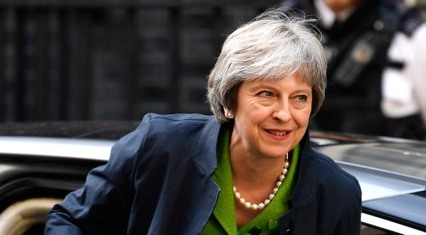 Mrs May returns to Downing Street after seeing off a threatened rebellion on Brexit