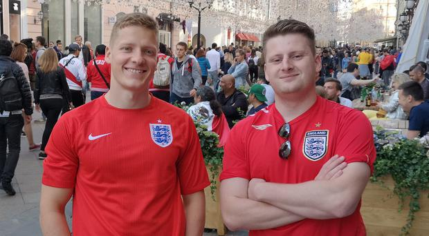 England fans take in the atmosphere of Nikolskaya Street, near Red Square (Scott D'arcy/PA)