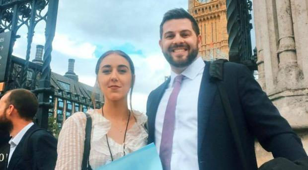 Upskirting victim and campaigner Gina Martin with lawyer Ryan Whelan outside the Houses of Parliament (Gina Martin/PA)