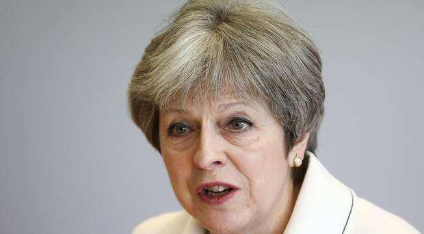 Theresa May has intervened after a Tory MP derailed moves to legislate on upskirting (Simon Dawson/PA)