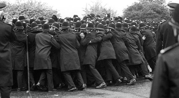 Police officers pushing against striking miners outside the Orgreave Coking Plant (PA)