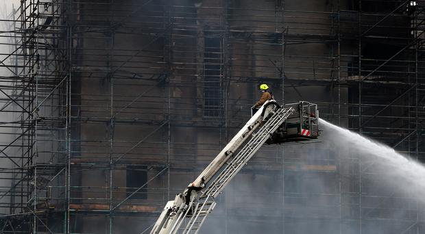 Hosing down at the historic Mackintosh Building in Glasgow battle the blaze at the Glasgow School of Art building (Andrew Milligan/PA)