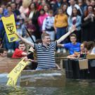 Cambridge University students in boats made from cardboard float down the River Cam (Joe Giddens/PA)