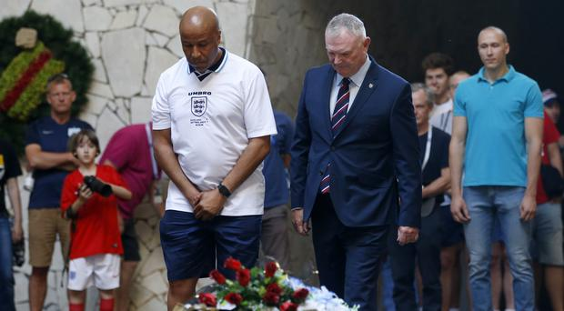 Chairman of the FA Greg Clarke (right) lays a wreath at the Hall of Military Glory at the Mamayev Kurgan (Owen Humphreys/PA)