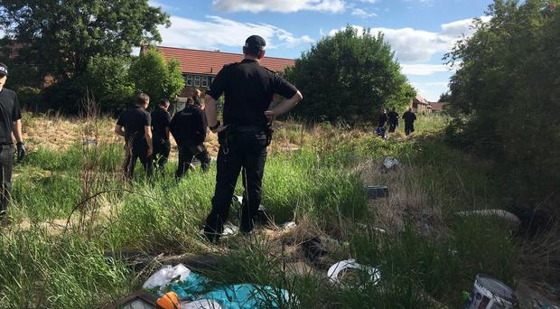 A specialist search team begins to excavate an area of waste ground in Middlesbrough in the search for missing teenager Donna Keogh (Cleveland Police/PA)