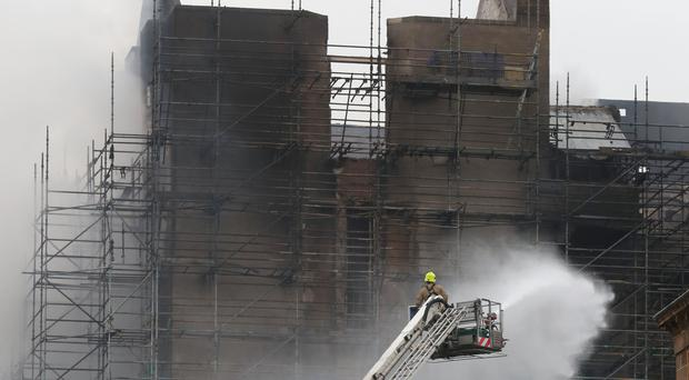 Firefighters at the historic Mackintosh Building in Glasgow battle the blaze at the Glasgow School of Art building (Andrew Milligan/PA)