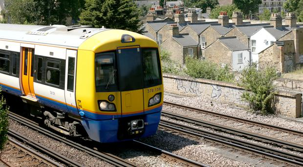 A train near Loughborough Junction railway station, close to Brixton in south London where three people have died in unexplained cirumstances (Yui Mok/PA)