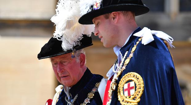 Prince of Wales (left) and the Duke of Cambridge attending the annual Order of the Garter Service at St George's Chapel, Windsor Castle.