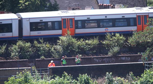 Police activity on a railway track near Loughborough Junction railway station, close to Brixton in south London where three people have died in unexplained circumstances
