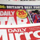 The takeover of the Express and Star newspapers by the owner of the Daily Mirror has been cleared by the Government (Yui Mok/PA)
