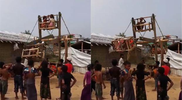 Footage shows a line of children awaiting their turn in front of one of the wooden structures in the Balukhali camp (Julia Brothwell/British Red Cross)