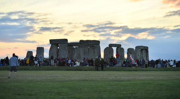 People gathering at Stonehenge to mark the summer solstice on Thursday (Ben Birchall/PA)