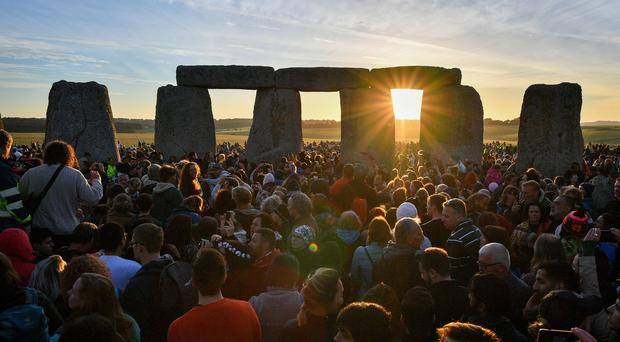 The sun shines through the stones at Stonehenge (Ben Birchall/PA)